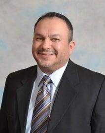 man smiling wearing suit
