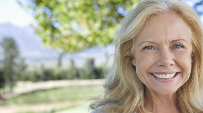 Portrait of smiling mature woman in park